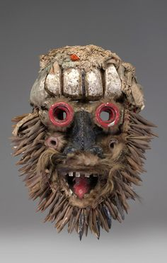 Africa | Mask from the Wee culture of Ivory Coast | Wood, paint, fur, fabric, hair, metal, fiber, bone | 19th - 20th century