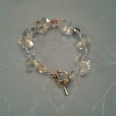 Quartz nugget bracelet New, never worn, handmade clear Quartz  nugget bracelet. It is accented with multicolor Czech glass faceted beads. The bracelet is about 8 inches long. Jewelry Bracelets