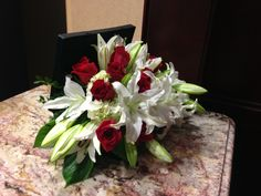 White lilies, red roses, white hydrangea in a black box - side view
