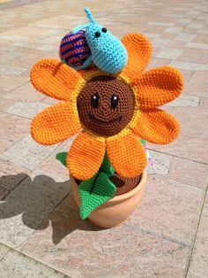 Blume mit Schnecke