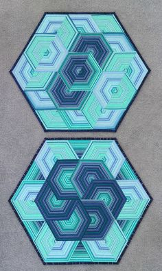 Last year I went to a class with Shirley Mooney of Don't Wait to Create blog, and learnt how to cut a striped fabric to make new patterns. This is the result.  I finished the first quilt quite soon af
