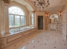 This bathroom is bigger than my bedroom. Who needs a bathroom this big.