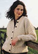 Ladies Aran Irish Knit Button Down Cardigan Ladies Aran Irish Knit Button Down Cardigan. An all time classic, a traditional Aran cardigan for women. The sweater features the traditional Aran honeycomb pattern. It is knitted from 100% pure Irish Merino wool. Button front with two pockets. The sweater is made in in County Mayo ,Ireland. Available in Natural and Green. Sizes available: XSmall, Small, Medium, Large, XLarge and XXLarge.