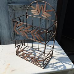 Rusty Metal Shelf 2 Tier Wall Shelf with Leaves Wire Basket Wall Decor Garden Decoration Rusty Wire Country Wedding Flowers Wall  Display by Pincapallina on Etsy https://www.etsy.com/listing/239673997/rusty-metal-shelf-2-tier-wall-shelf-with