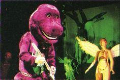Kurt Cobain playing guitar in a Barney suit! ~ just when i thought i couldn't love him anymore!!