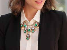 Wear a statement necklace under your collar shirt and transform classic office wear into an edgy outfit.