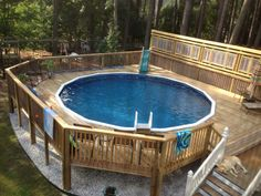 """This is a customer photo of a Barbados 52"""" 24' round pool installed in a custom deck."""