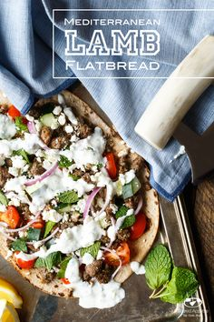Mediterranean Lamb Flatbread | sharedappetite.com  An easy weeknight dinner pizza recipe featuring lots of fresh Greek flavors including a dynamite Tzatziki sauce!