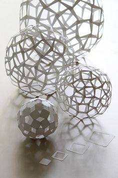 Each sphere is made of 60 squares. Based on Trapezoidal Hexecontahedron (60 squares)  Four sizes of square are cut out from the same sheets of paper. t=0.2mm paper, unit sizes: 17, 24, 34 and 48 mm  Making Video: vimeo.com/15047493