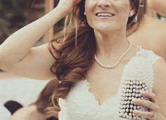 Bride hair and dress and glamglass