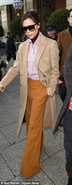 Individual flair: The fashionista and mum-of-four lead the group out of the £800-per-night...