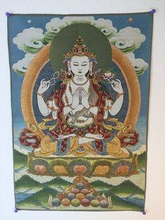 Avalokiteshvara with a Green Halo on Blue Background