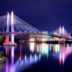 Portland's newest bridge, the Tilikum Crossing Bridge, is almost finished. As opposed to the other bridges spanning the Willamette River the Tilikum Crossing is for light rail, cyclists and pedestrians only. Portland, Oregon. (Photo credit: Mike Warner, Portland photojournalist)