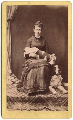 A mourning mother with her baby or a post mortem image of a mother and her child. Late 1870s.