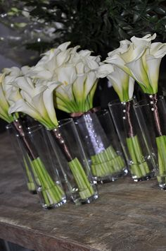 long table centerpieces, smaller lilies shorter vases and run down the middle of the table