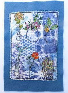 "Jane LaFazio: Flowers in the Window"" (12x7.5""), using free motion machine stitch and hand embroidery to enhance a quilt image"