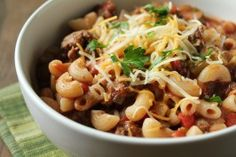 Classic Goulash: beef, onion, bell pepper, diced tomatoes + tomato sauce, pasta, cheese. Add mushrooms, corn.