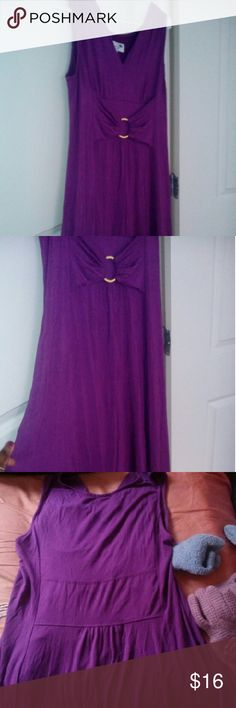 "Long purple dress by Liz lange Worn once. In mint condition. Soft stretchy fabric. Long to the ankles. 52"" long from shoulder to bottom. A shape n a bit flared from waist down. Deep v neck. Sleeveless. Bow like design in front with a round gold hoop. Back also has a few gathers in middle. This is medium but am a large. It fits. Can fit an xl too. Because its really stretchy.. 94% rayon. 4% spandex. True color is the first 3. Great color. Really flattering. Great for summer. Liz Lange Dresses…"