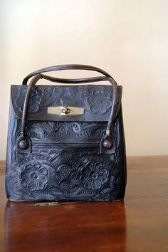 60s Black Leather Bag // Embossed Leather by 86Vintage86 on Etsy, $298.00