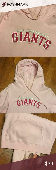 Cozy Pink San Francisco Giants Pull Over Hoodie Super cozy and comfy light pink San Francisco Giants baseball pull over hoodie. Drawstring pulls and tie around hood. Front pocket. Practically unworn. Authentic merch originally purchased from a home game. Tops Sweatshirts & Hoodies