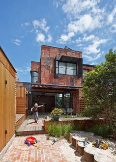 Outside view from the rear part of the house.  Cubo House by PHOOEY Architects. Photography © Peter Bennetts.