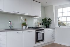 The simple modern kitchen has a countertop from Silestone in Kensho and the cabinets are Ikea. They bought their appliances from Neff.