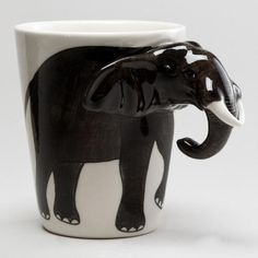 Adding a splash of fun to your morning beverage, our lifelike Elephant Mug is artfully handcrafted in Thailand of durable earthenware, exclusively for World Market. This unique and affordable piece delivers big smiles even before the coffee is poured.