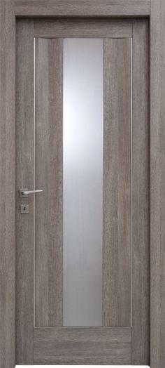 Due onde che fanno naufragare lo sguardo. Una #porta piena, viva come il #mare. Modello Sarah 1V. Codice : 2O.2I.1V in legno listellare. #Rivestimento esterno in Laminato. Colore: #Grigio Poro. Catalogo Ensemble. #porte #infissi #vetro #inserti
