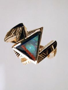 Serie Triangolo rings available in Gold or in Silver, with inlay of semiprecius stone and opal  Sergio Figar