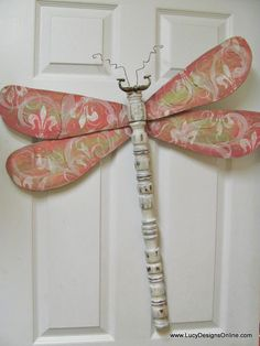 Wooden candlestick for the body, a drawer pull for the eyes and head and the wings are ceiling fan blades that are painted and stamped. Too clever and think of the possibilities! By Lucy Designs with a TUTORIAL at this link.