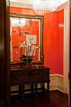 Orange lacquer walls create drama in this foyer - designer christina murphy Orange Walls, Red Walls, Beautiful Interior Design, Beautiful Interiors, Foyers, South Shore Decorating, Orange Interior, Entry Foyer, House Colors