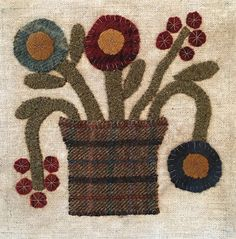 Little Wool Sampler Kit includes background fabric, and wool. This is block one.
