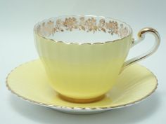 Paragon Yellow Ground Gold Floral Band Flower Teacup Set
