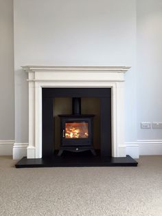 Chesneys Beaumont 5kw wood burning stove with limestone surround, slate hearth and slips.