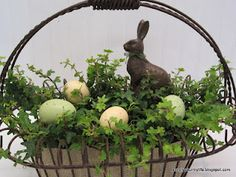 Easter planter centerpiece. I like the neutral colors....the usual Eastery pastels don't really match anything in my house!