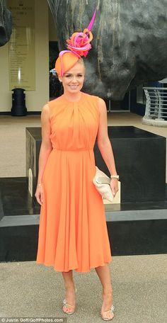 Welsh soprano Katherine Jenkins's orange and pink #fascinator on day one of Royal Ascot. Not too crazy with the abundance of orange she has on, though.