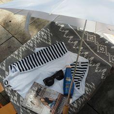 Sunbella umbrella | Idlebird cover-up | Karen Walker sunnies | Knotty beach towel | NIVEA moisturising sunscreen SPF50+ | Daring and Disruptive by Lisa Messenger