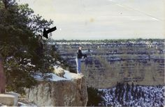My uncle, standing on the edge of the cliff, claims he does not know the man in black and that he was not there when the picture was taken. Unsettling stuff.
