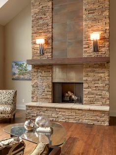Toronto alta modern chalet beige wall chalet fireplace glass coffee table metal fireplace rustic wood floor ski chalet slanted ceiling stacked stone fireplace stone fireplace tile wall sconce wall sco « Lovely Home designs Rustic Fireplace Decor, Modern Stone Fireplace, Stone Fireplace Wall, Stone Fireplace Designs, Stacked Stone Fireplaces, Rustic Fireplaces, Home Fireplace, Fireplace Remodel, Living Room With Fireplace