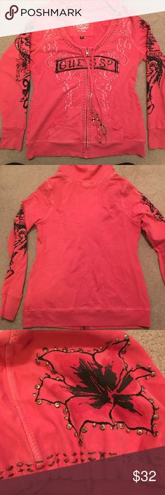 GUESS Coral Embellished Hoodie ⚡️FLASH SALE ⚡️Unique and beautiful embellished GUESS hoodie. Scoop beck zip up. Both sleeves are embellished, logo in the front, and part of the hood. Great coral color. Beads decorate the end of the hoodie strings. Excellent condition; fabric provides great stretch.  True to size. Size XL. Guess Tops Sweatshirts & Hoodies