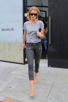 Rosie Huntington-Whiteley in Isabel Marant top and trousers, Ray-Ban sunglasses, Anita Ko, Jennifer Fisher, Neil Lane, and Rolex jewelry, Saint Laurent bag, and Aperlai shoes.
