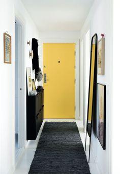 Black & yellow hallway with Ikea 'Trones' shoe cabinets