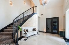 Welcome home; The formal entry has a marble floor and an impressive staircase with leopard...