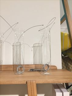 Hanging beakers from homestolife. Put fairy lights inside and hang either side of a bed.