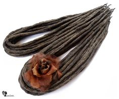 Wool dreadlocks  Shea Walnut  DE  Type: Double Ended Material: Worsted wool Method: Felted, handmade Pieces in set: Choose the quantity in the listing options Lenght: 30-40 inch (80-100cm) - 15-20inch (40-50cm) folded in half Thickness: 0.39-0.79 inch (1-2cm) Color: brown shades mix  Quantity: If you have a mohawk - 30 pieces will be enough If you have a thin hair - 40 pieces will be enough If you have a tchick hair - you need 50-60 pieces   Wool dreadlocks have many advantages:  * Light –…