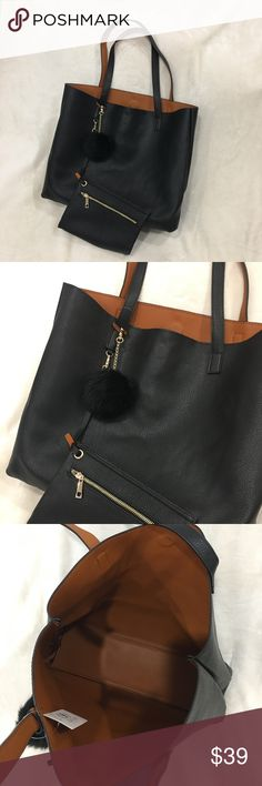 """Reversible Vegan Leather Tote NWT. Reversible Faux Leather Tote back. Black/Tan. Attached clutch included. Fits literally everything! My laptop, small blanket, large wallet, sunglasses in case all fit! Magnetic closures. Classic gold hardware. Coin bag with zipper closure. Shoulder strap drops 9.5"""". Size: 15.5"""" x 13"""" x 5.5"""". Price Firm. Bags Totes"""
