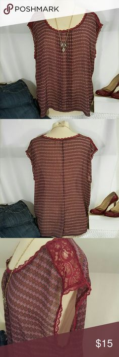 Sheer sleeveless top sheer, sleeveless blouse with lace trim and lace shoulder detail. Route 66 Tops