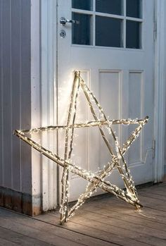 Star made from sticks and fairy lights. The perfect Christmas decoration. #DIY #PANDORAloves