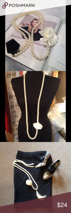 Pearl Strand with Flower Accent This simple and classic style faux pearl strand measures 52 inches long, Great addition to your jewelry collection. (This closet does not trade or use PayPal) Boutique Jewelry Necklaces