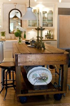 This kitchen is drool worthy...Large kitchen dishes - store under table